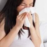 Photo - femme enceinte avec la grippe